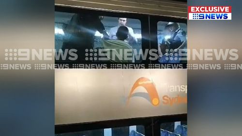 Officers boarded a train at Town Hall railway station around midday and arrested the man. (9NEWS)