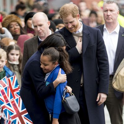 Meghan hugs a child in Birmingham, 8 March 2018