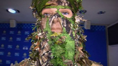 The attacker wore a camouflage suit.