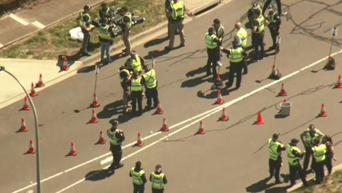 Police wait for the bikies to arrive so they can carry out checks.