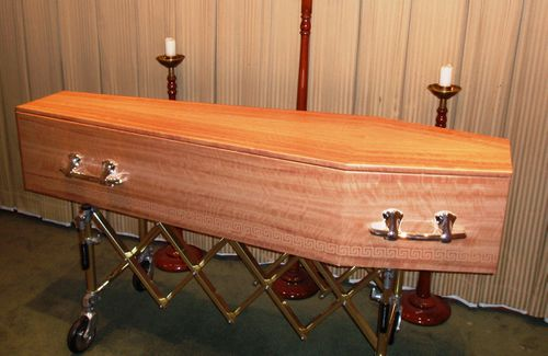 The 74-year-old grandmother was moved from her oak, silk-lined coffin to a pine box similar to this (AAP).