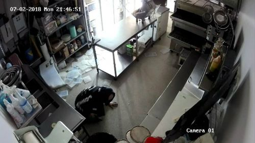 The thief fell to the ground during his robbery of the pizza store. Picture: Supplied