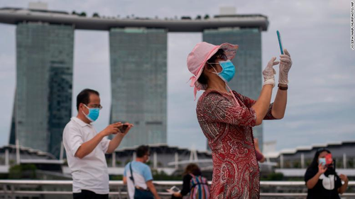 People were still wearing masks and gloves while visiting Singapore's Marina Bay.