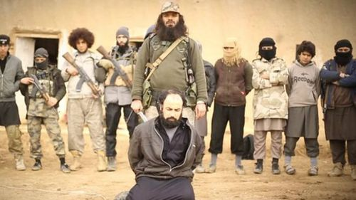 Fugitive Australian terrorist Khaled Sharrouf appears to execute a spy in a new ISIL video. (Supplied)