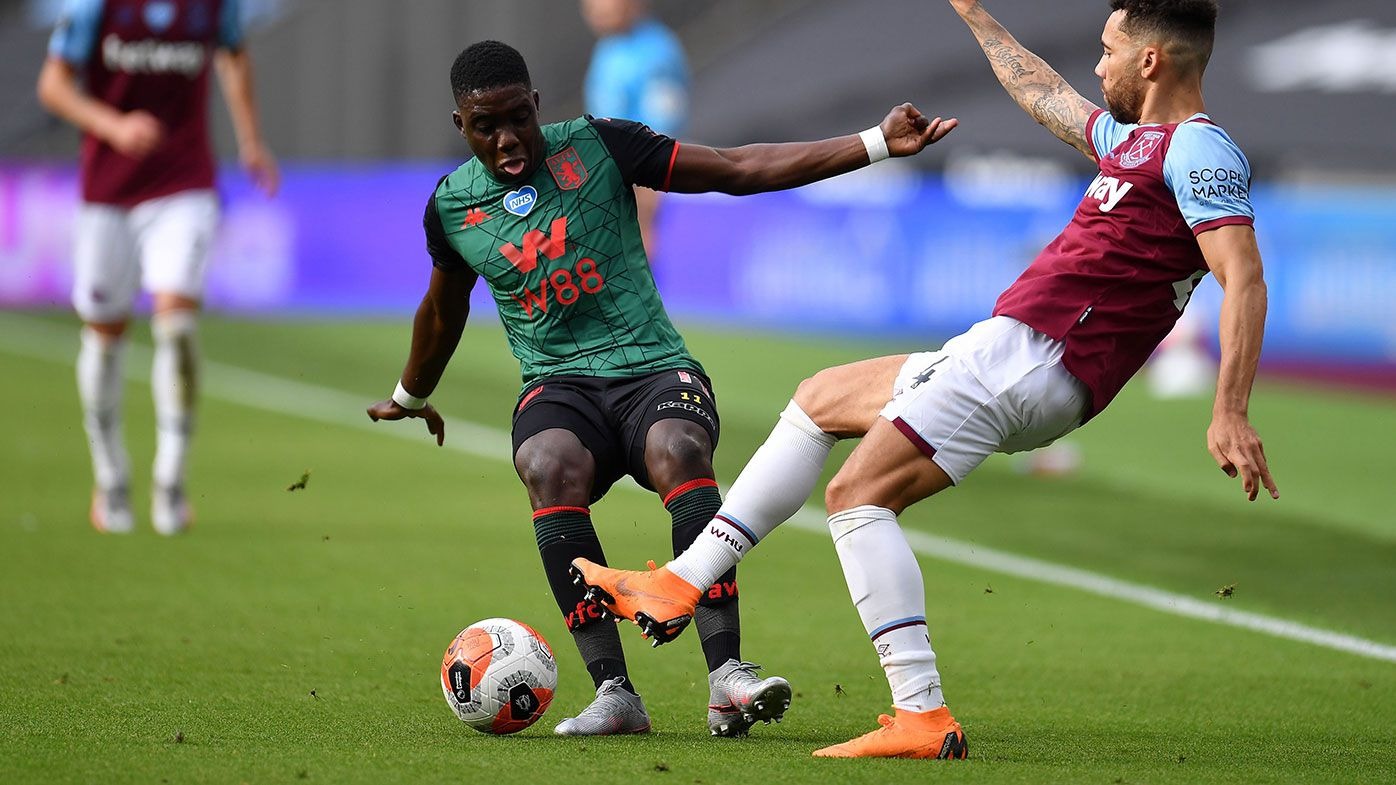 Marvelous Nakamba of Aston Villa battles for possession with Ryan Fredericks of West Ham United.