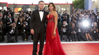 Actor Matt Damon, left, and his wife Luciana Barroso pose for photographers at the premiere of the film 'Downsizing' which opens the 74th edition of the Venice Film Festival in Venice, Italy, Wednesday, Aug. 30, 2017.