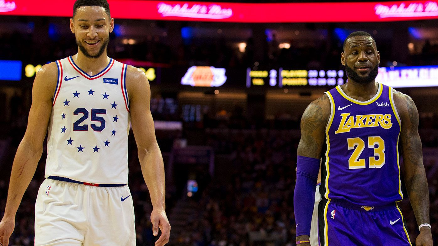 Ben Simmons #25 of the Philadelphia 76ers talks to LeBron James #23 of the Los Angeles Lakers