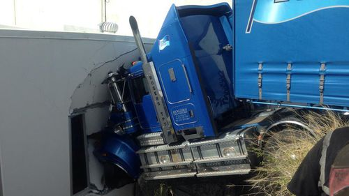 The truck was unoccupied when it rolled off. (9NEWS)