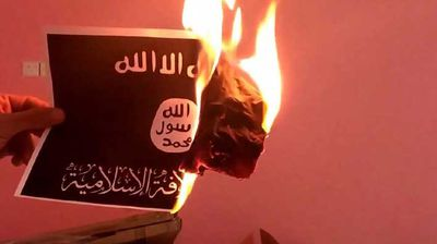 After Ali Al-Sayyed's murder on August 28, protesters in Lebanon burned the ISIS and Al-Nusra flag, which bears the text of the Shahada – the Islamic profession of faith.