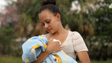 Honduran migrant Genesis Martinez, 18, poses for a picture holding her two-month-old son Cesar. (AP)