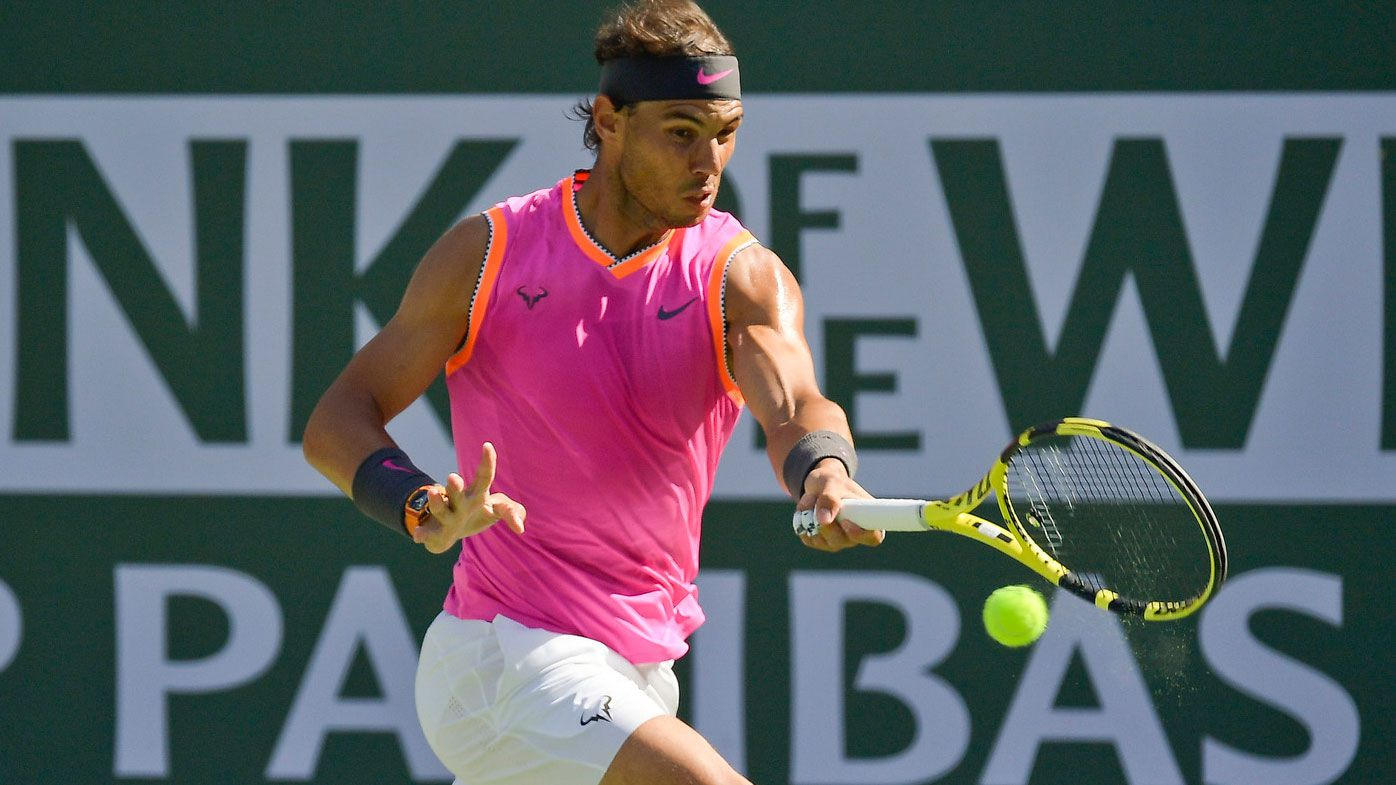 Rafael Nadal, of Spain, hits a forehand to Karen Khachanov, of Russia, at the 2019 BNP Paribas Open tennis tournament in Indian Wells