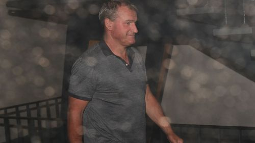 Darren Weir is seen departing the Victorian Racing Club's headquarters during after a show cause hearing in Melbourne.