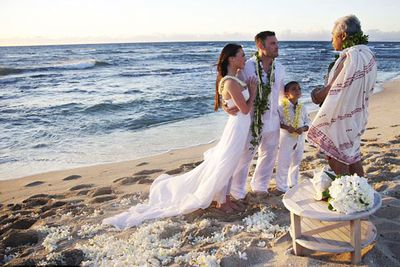 Of course Megan was going to make a babelicious bride!<P><br/>The photogenic couple wed on the beach in Hawaii, with Brian's young son on hand to deliver the rings.