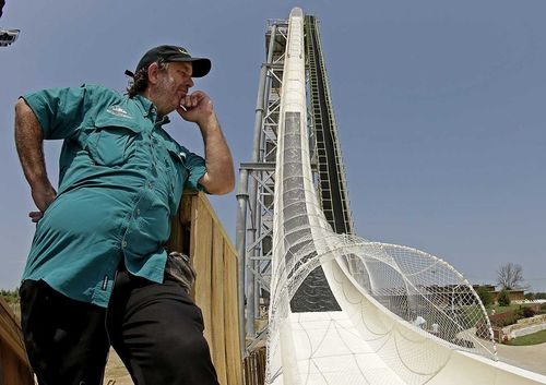 Jeffrey Henry poses beside the waterslide he designed.