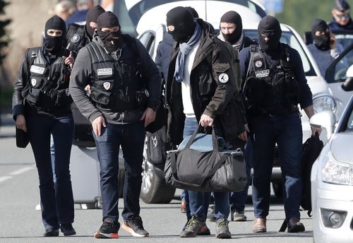 Tactical police clad in balaclavas riot gear were deployed during the tense standoff in the supermarket. (AAP)