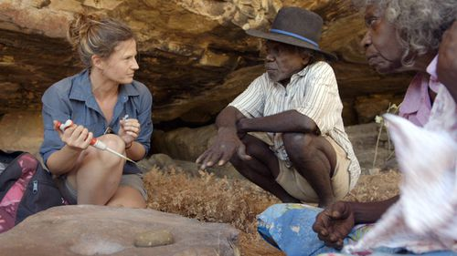 Elspeth Hayes with Mark Djandjomerr and traditional owner May Nango extracting samples at a cave adjacent to the Madjedbebe rock shelter in the Kakadu National Park in the Northern Territory (AAP Image/Gundjeihmi Aboriginal Corporation, Vincent Lamberti).