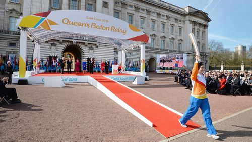 Anna Meares begins the baton relay outside Buckingham Palace. (AAP)