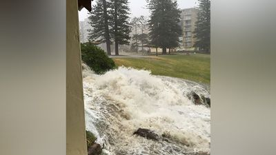 This photo of water gushing through a suburb was taken in Cronulla today. The storm was forecast to hit around the Sydney CBD near midday. (Twitter/@danieljcarrr)