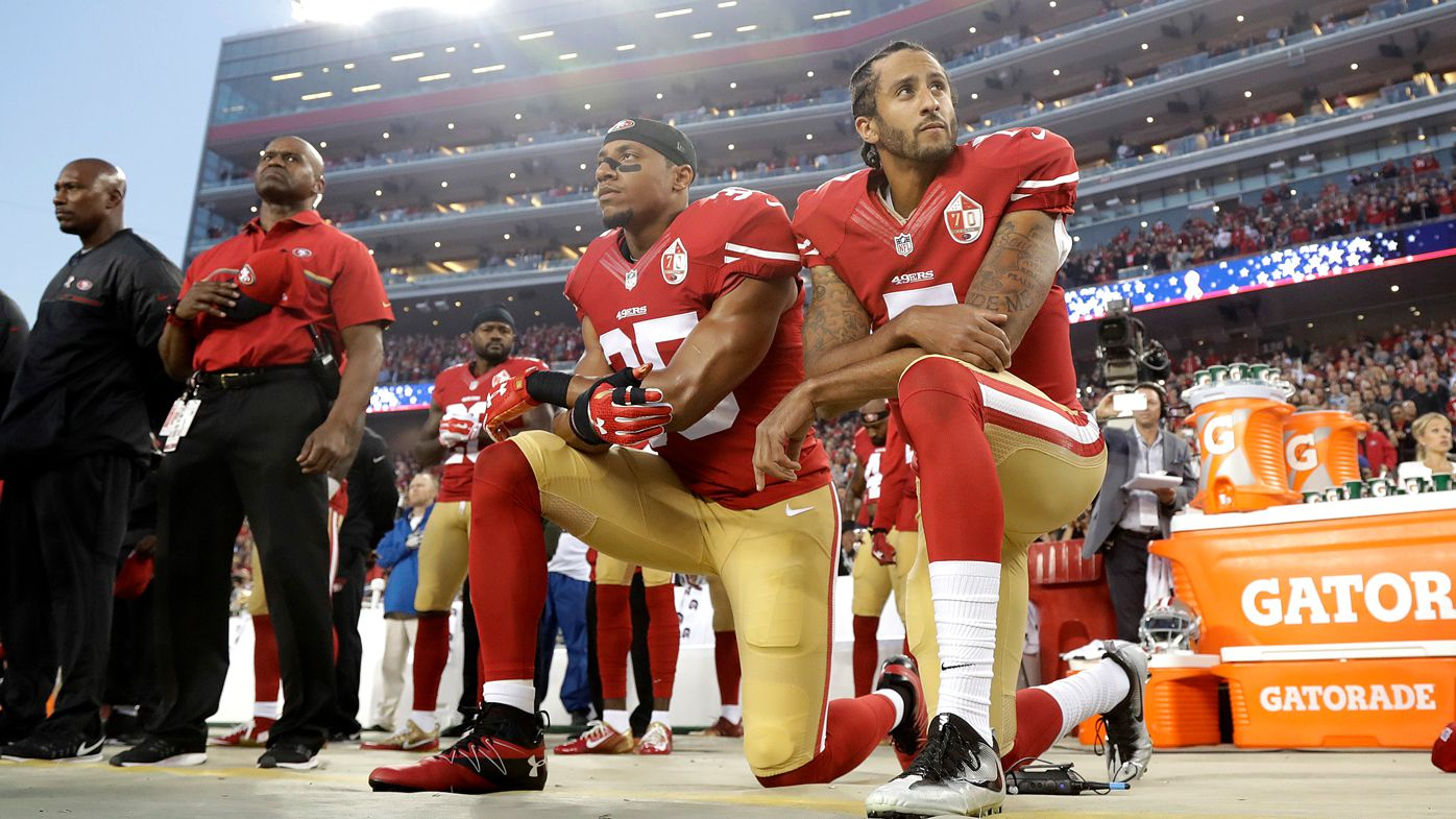 San Francisco 49ers safety Eric Reid (left) and quarterback Colin Kaepernick kneel during the national anthem before a 2016 NFL football game against the Los Angeles Rams.