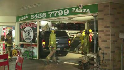 Woman crashes car into pizza shop packed with families