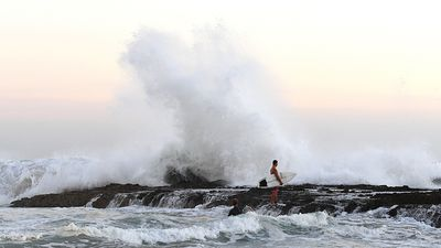 Wild surf batters east coast with scorching heat to return