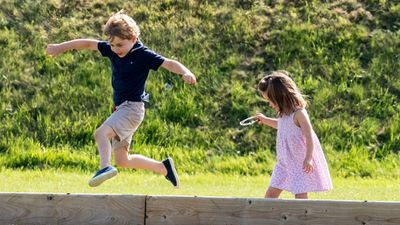 Prince George plays with Princess Charlotte at the polo, June 2018