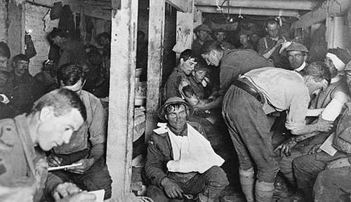 Wounded Australian soldiers receive treatment at a medical post during The Battle for the Menin Road in 1917. (Photo: Australian War Memorial).