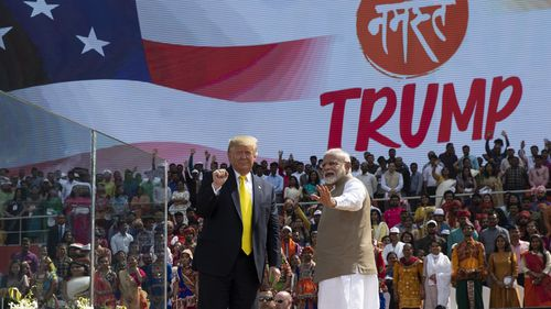"Mr Trump and Indian Prime Minister Narendra Modi wave after the ""Namaste Trump"" event."