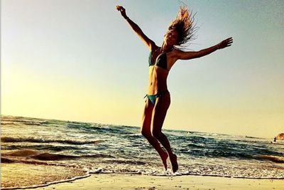 We'd be jumping for joy too if we were at this beach. And looked like Bar Refaeli.<br/><br/>(Image: Instagram)