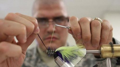 In a Fort Hood Herald photo from 2010, gunman Spc. Ivan Lopez is shown tying a fly during an instructional class. (Supplied)