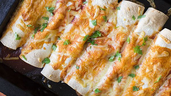 Chicken and bean enchiladas with salad
