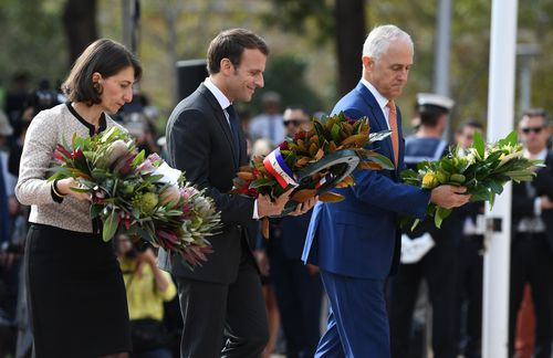 President Emmanuel Macron pays his respects to fallen French and Australian soldiers at Sydney's Anzac Memorial. Picture: AAP
