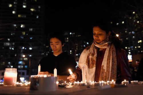 Mourners in Toronto light candles at a makeshift memorial for the victims mown down by the rental van. Picture: AP/The Canadian Press