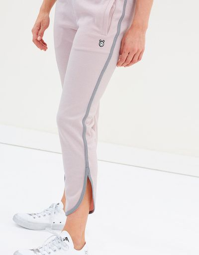 "<a href=""https://www.theiconic.com.au/converse-x-miley-glitter-tulip-track-pants-633300.html"" target=""_blank"">Converse X Miley Glitter Tulip Track Pants in Pink Dogwood, $130</a>"
