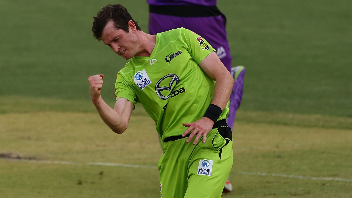 Adam Milne of the Thunder celebrates the wicket of Macalister Wright of the Hurricanes.