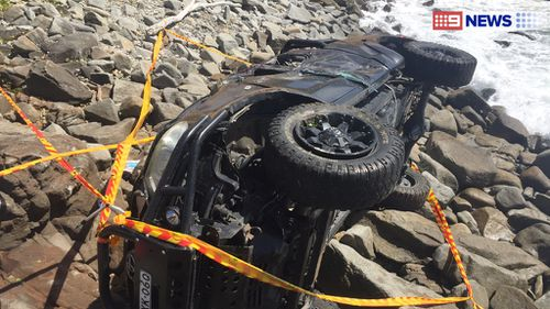 Men escaped with cuts after 4WD rolled over Yamba cliff and onto beach