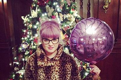 What would the Fashion Police think of Kelly Osbourne mixing and matching purple, animal print and Christmas?