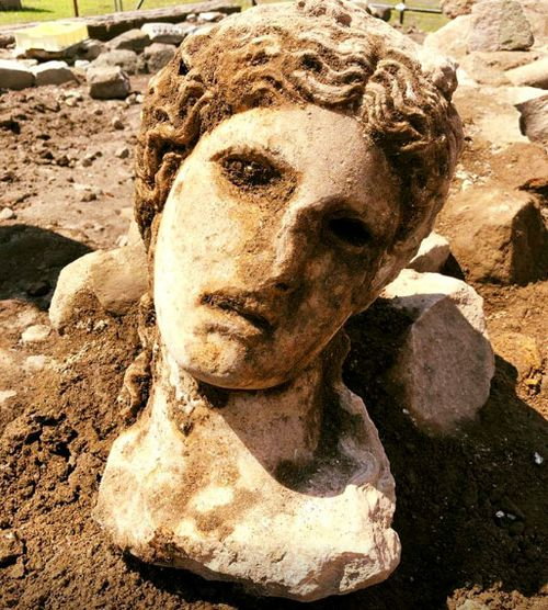 Ancient marble head of 'fertility god' unearthed in Rome
