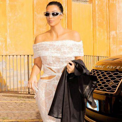 Kim Kardashian drops by the Vatican church for a visit in lace cutout dress.