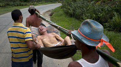 A man is stretchered to medical help after the storm hit Cuba. (AP)