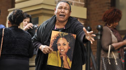 Ethiopian woman Wubanchi Asfaw, pictured in a photo held by her mother, was stabbed to death by her husband in Sydney in 2014.