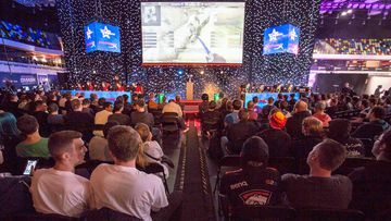 Gamers watch a cup game between Denmark and Australia playing Counter Strike Global Offensive at Dreamhack, the world's largest digital festival and meeting place for gamers, fans and e-sport enthusiasts at London's Copper Box Arena. (AFP)