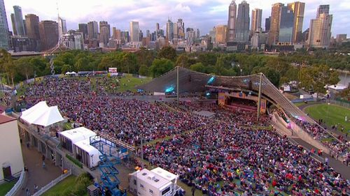 At least 10,000 are at the Sidney Myer Music bowl for Carols by Candlelight. (Channel 9)