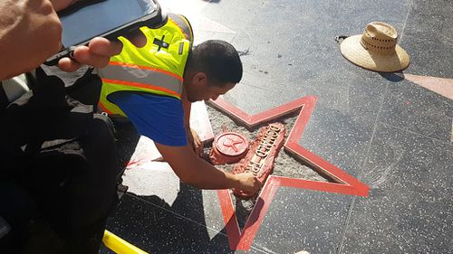 A repair crew is already replacing the defaced star. (9NEWS/Ehsan Knopf)