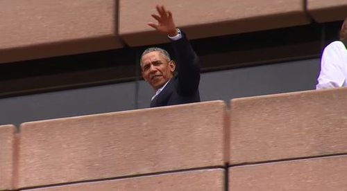 Barack Obama waves at crowds during a trip to the Sydney Opera House (9NEWS)