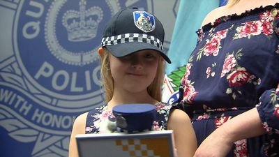 Young girl made junior cop after saving dad's life with Triple Zero call