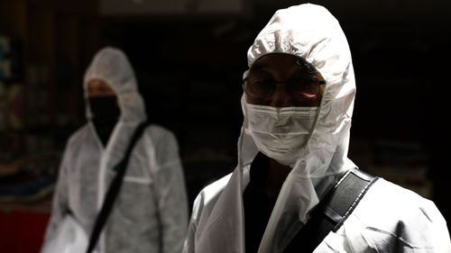 Disinfection professionals, wearing protective gear, spray antiseptic solution to guard against the coronavirus (COVID-19) at a department store on March 02, 2020 in Seoul, South Korea.