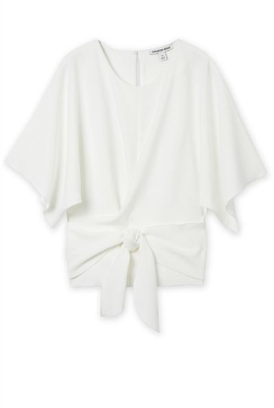 """<p><a href=""""https://www.countryroad.com.au/shop/woman/clothing/t-shirts-and-tops/60214624/Textured-Wrap-Top.html"""" target=""""_blank"""" draggable=""""false"""">Country Road Textured Wrap Top in Antique White, $119</a></p>"""