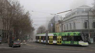 Fog is seen over the the top end of Bourke St on July 17, 2020 in Melbourne, Australia. Metropolitan Melbourne and the Mitchell shire are currently in lockdown following the rise in COVID-19 cases through community transmissions.