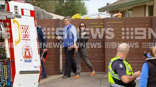 A woman has been arrested after a house fire in Melbourne's south-east.